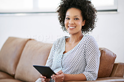 Buy stock photo Portrait of an attractive woman relaxing at home with a digital tablet