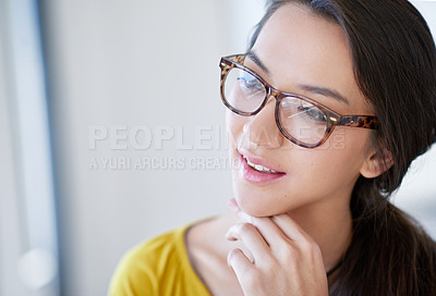 Buy stock photo Shot of an attractive young woman in an office