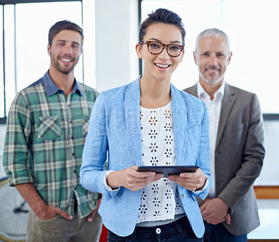 Buy stock photo Portrait of a group of colleagues standing in an office