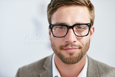 Buy stock photo Shot of a young man standing in an office