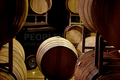 Buy stock photo Cropped shot of a wine barrels in a storehouse