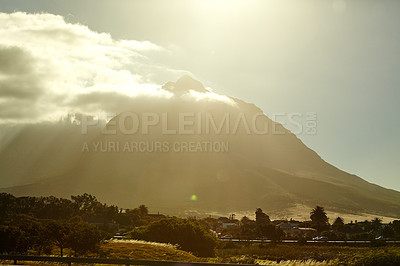 Buy stock photo A sunset behind cloudy mountains