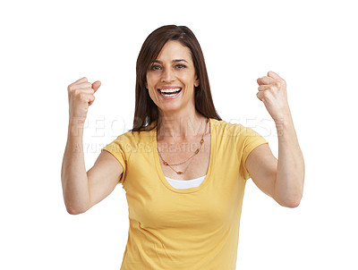 Buy stock photo Studio portrait of a mature woman celebrating a victory