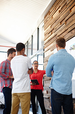 Buy stock photo Shot of a group of designers discussing ideas in a meeting