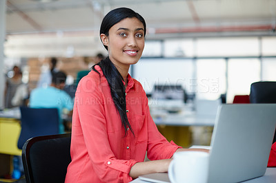 Buy stock photo Portrait of a young female designer working at her computer