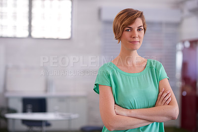 Buy stock photo Shot of an attractive designer standing in a large office