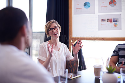 Buy stock photo A young woman taking the lead in a meeting with colleagues
