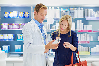 Buy stock photo Shot of a clinician and customer standing in a cosmetics store