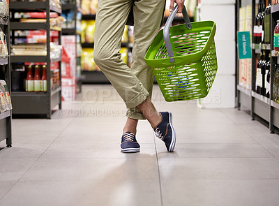 Buy stock photo Cropped image of a young man's legs and grocery basket