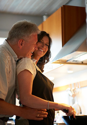 Buy stock photo Cropped shot of a senior couple cooking in the kitchen