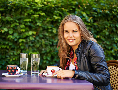 Buy stock photo A beautiful teen sitting at a bistro with a cup of coffee