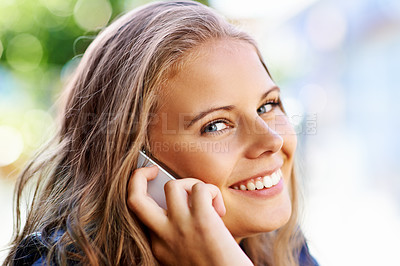 Buy stock photo Portrait of a beautiful teen talking on her cellphone