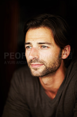 Buy stock photo Portrait of a handsome young man looking off into the distance