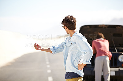 Buy stock photo Two male friends getting frustrated at the lack of help after breaking down