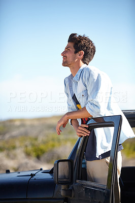 Buy stock photo A young man gazing into the distance
