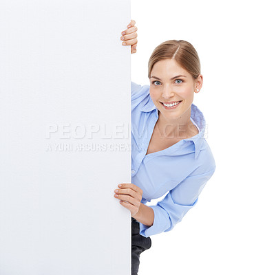 Buy stock photo Studio shot of a beautiful young businesswoman hiding behind a blank white wall