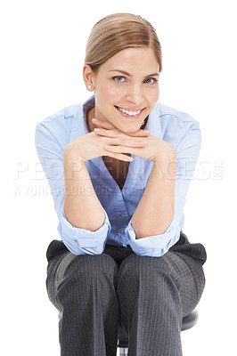 Buy stock photo Studio shot of a beautiful young businesswoman sitting on a chair against a white background