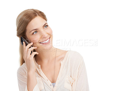 Buy stock photo Studio shot of an attractive young woman talking on a mobile phone against a white background