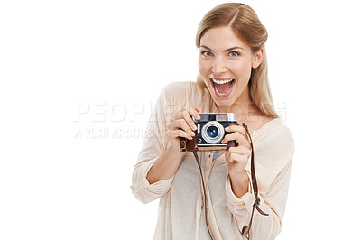 Buy stock photo Studio shot of a beautiful young woman holding a camera against a white background