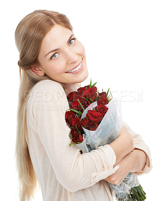 Buy stock photo Studio shot of a beautiful young woman holding a bouquet of red roses against a white background