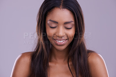 Buy stock photo Cropped shot of a beautiful young woman posing with her eyes closed in the studio