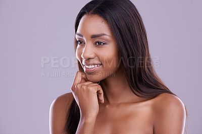 Buy stock photo Cropped shot of a beautiful young woman in the studio