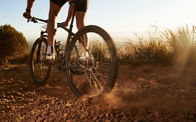 Buy stock photo Cropped shot of a man cycling through off road terrain