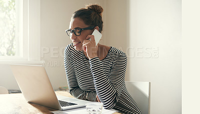 Buy stock photo Cropped shot of a young student talking on her cellphone while sitting by her laptop