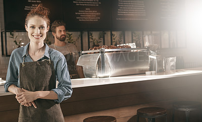 Buy stock photo Portrait of a barista in a cafe with a coworker in the background