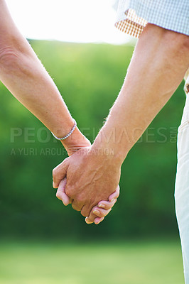 Buy stock photo Cropped image of a couple holding hands