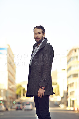 Buy stock photo Shot of a handsome hipster standing in the city