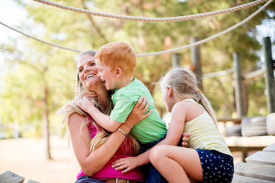 Buy stock photo Shot of a mother and two children spending time outdoors