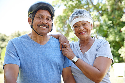 Buy stock photo Shot of a happy senior couple enjoying their exercise together outdoors