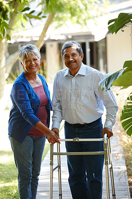 Buy stock photo Portrait of a senior woman helping her husband adjust to his new walker