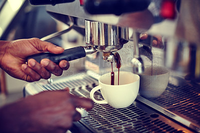 Buy stock photo Closeup shot of a male barista using an espresso machine to make a cup of coffee