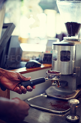 Buy stock photo Shot of a barista preparing grind coffee for brewing