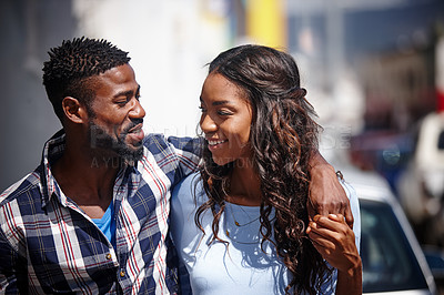 Buy stock photo Shot of an affectionate couple walking outdoors