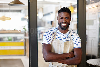 Buy stock photo Portrait of a handsome young man standing at the entrance to his coffee shop