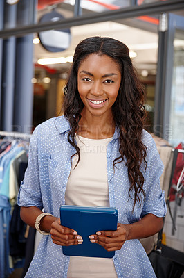 Buy stock photo Close up cropped shot of a woman holding a digital tablet in a clothing boutique