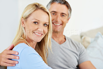 Buy stock photo Portrait of a smiling mature couple at home
