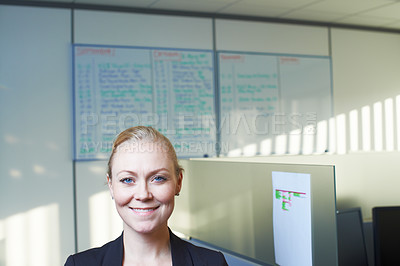Buy stock photo Portrait of an attractive businesswoman standing in the office