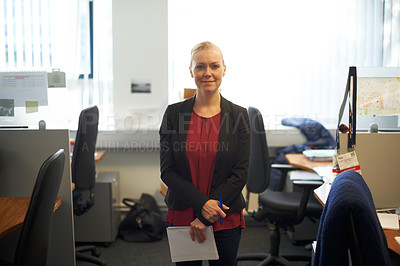 Buy stock photo Portrait of an attractive businesswoman holding paperwork in the office