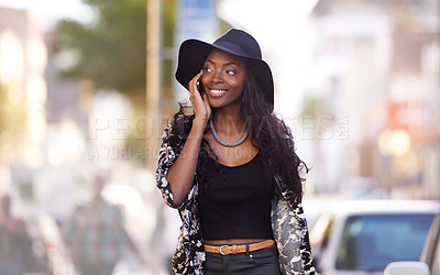 Buy stock photo Shot of an attractive woman talking on her mobile phone in the city