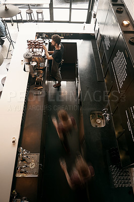 Buy stock photo High angle shot of a male barista making a cup of coffee