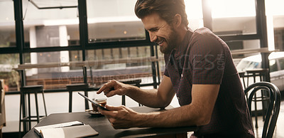 Buy stock photo Shot of a young man working at a coffee shop