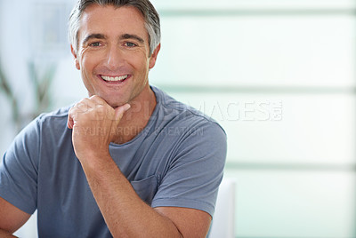 Buy stock photo Cropped shot of a handsome mature man relaxing at home