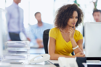Buy stock photo Cropped shot of an attractive young businesswoman working at her office desk