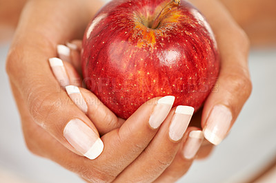 Buy stock photo Closeup shot of hands holding out a fresh red apple