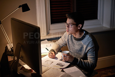 Buy stock photo Cropped shot of a young student studying late into the night