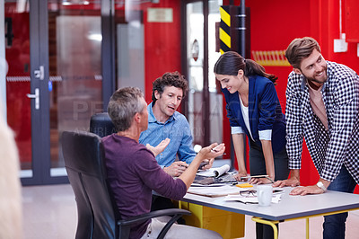 Buy stock photo Cropped shot of creative professionals having a meeting